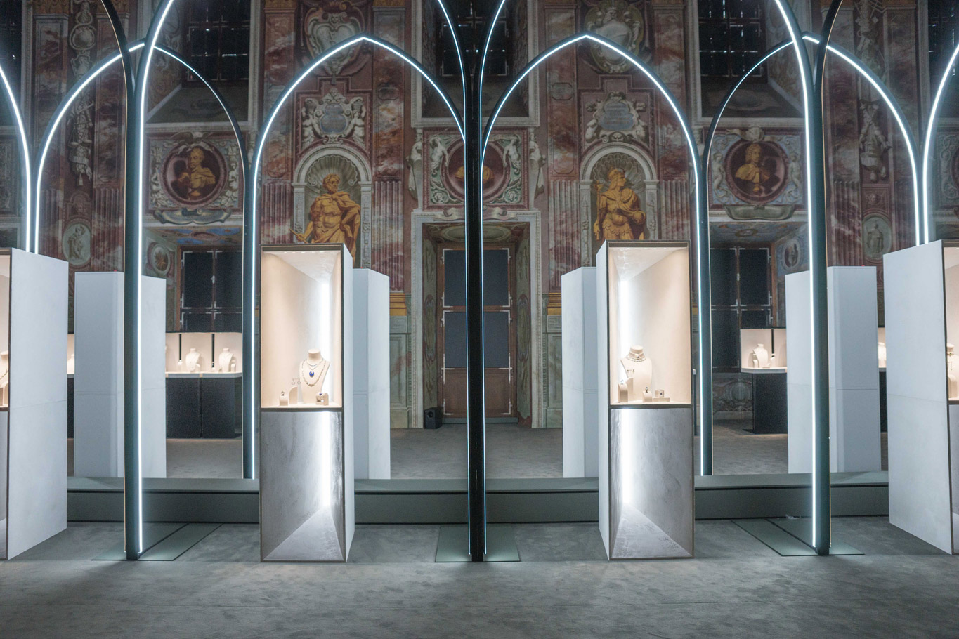 Photograph of the alcoves at the Louis Vuitton Haute Joaillerie exhibition with silver rectangle display