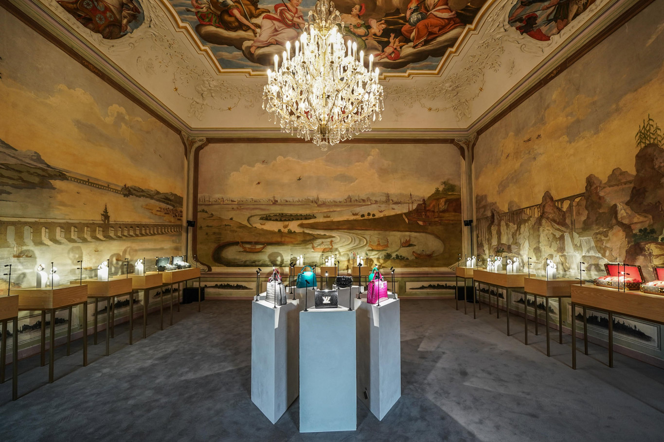 Room painted in an 18th century style, with an antique ceiling fresco dressed by a large chandelier. This room was decorated for the Louis Vuitton High Jewellery exhibition in Shanghai.